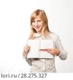 Купить «Девушка с брекетами левой рукой указывает на тетрадь», эксклюзивное фото № 28275327, снято 12 сентября 2010 г. (c) Давид Мзареулян / Фотобанк Лори