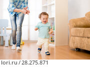 Baby boy have a fun running in living room with his mother. Стоковое фото, фотограф Оксана Кузьмина / Фотобанк Лори