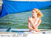 Купить «woman sitting on sail boat or yacht», фото № 28277387, снято 25 июля 2017 г. (c) katalinks / Фотобанк Лори