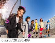 Купить «Happy girl rollerblading with friends at stadium», фото № 28280499, снято 14 октября 2017 г. (c) Сергей Новиков / Фотобанк Лори