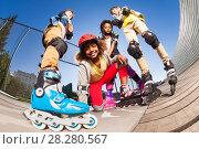 Купить «African girl rollerblading with friends outdoors», фото № 28280567, снято 14 октября 2017 г. (c) Сергей Новиков / Фотобанк Лори