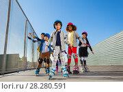 Купить «Preteen kids rollerblading outdoors at stadium», фото № 28280591, снято 14 октября 2017 г. (c) Сергей Новиков / Фотобанк Лори