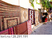Купить «Sale of antique carpets on the streets of the Old City of Baku. Azerbaijan», фото № 28291191, снято 23 сентября 2015 г. (c) Евгений Ткачёв / Фотобанк Лори