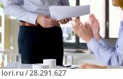 Купить «business team at office meeting or presentation», видеоролик № 28291627, снято 6 апреля 2018 г. (c) Syda Productions / Фотобанк Лори