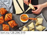 Купить «Woman is shaping dough to bake French croissants», фото № 28296519, снято 6 апреля 2018 г. (c) Oksana Zh / Фотобанк Лори