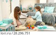 Купить «Dog playing with children in toys», видеоролик № 28296751, снято 14 августа 2017 г. (c) Tatiana Kravchenko / Фотобанк Лори