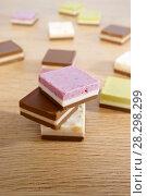 Купить «Шоколадные конфеты. Квадратный шоколад с фруктовой и ореховой начинкой.», фото № 28298299, снято 12 апреля 2018 г. (c) ирина реброва / Фотобанк Лори
