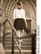 Купить «girl teenager going barefoot the stairs», фото № 28304067, снято 14 декабря 2019 г. (c) Яков Филимонов / Фотобанк Лори