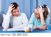Купить «Couple struggling to pay bills», фото № 28306523, снято 18 марта 2017 г. (c) Яков Филимонов / Фотобанк Лори