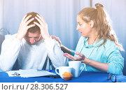 Купить «Couple struggling to pay bills», фото № 28306527, снято 18 марта 2017 г. (c) Яков Филимонов / Фотобанк Лори