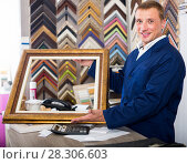 Купить «friendly workman holding wooden picture framing moulding», фото № 28306603, снято 19 января 2019 г. (c) Яков Филимонов / Фотобанк Лори