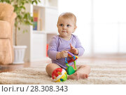 Купить «Smart baby with educatinal toys in sunny nursery room», фото № 28308343, снято 10 августа 2018 г. (c) Оксана Кузьмина / Фотобанк Лори