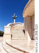 Купить «Marble spiral staircase on a sunny day», фото № 28308523, снято 23 сентября 2015 г. (c) Евгений Ткачёв / Фотобанк Лори