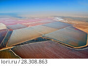Купить «Aerial view of one of the worlds largest salt mines located between Wallis Bay and Swakopmund in Namibia», фото № 28308863, снято 25 июня 2019 г. (c) BE&W Photo / Фотобанк Лори