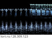 Купить «Glowing human chain, actors during performance at Impression-Liu Sanjie Show. Guilin Nightlife, Yangshuo, China.», фото № 28309123, снято 23 мая 2018 г. (c) BE&W Photo / Фотобанк Лори