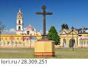 Купить «Cross on the churchyard of Ex-Convento de San Gabriel (San Pedro Cholula), Mexico», фото № 28309251, снято 27 мая 2019 г. (c) BE&W Photo / Фотобанк Лори