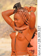 Купить «Himba tribe woman with ornaments on the neck, in the village of Himba people near Omuramba, Kaokoland, Kunene, Namibia», фото № 28309327, снято 26 мая 2019 г. (c) BE&W Photo / Фотобанк Лори
