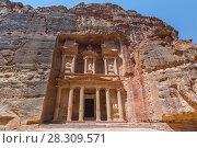 Купить «The Treasury of the Pharaoh building carved into the rock face at Petra in Jordan», фото № 28309571, снято 4 августа 2020 г. (c) BE&W Photo / Фотобанк Лори
