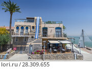 Купить «The old restored stone building located on the bank of Sea of Galilee is used as the restaurant, Tiberias, Israel», фото № 28309655, снято 23 июля 2019 г. (c) BE&W Photo / Фотобанк Лори