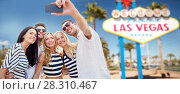Купить «friends travelling to las vegas and taking selfie», фото № 28310467, снято 13 июля 2014 г. (c) Syda Productions / Фотобанк Лори