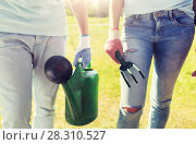 Купить «volunteers with watering can and weeding rake», фото № 28310527, снято 7 мая 2016 г. (c) Syda Productions / Фотобанк Лори