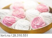 Купить «close up of zephyr or marshmallow on cake stand», фото № 28310551, снято 8 мая 2017 г. (c) Syda Productions / Фотобанк Лори