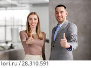 Купить «businesswoman and businessman showing thumbs up», фото № 28310591, снято 25 февраля 2018 г. (c) Syda Productions / Фотобанк Лори