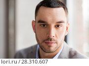 Купить «portrait of businessman in suit at office», фото № 28310607, снято 25 февраля 2018 г. (c) Syda Productions / Фотобанк Лори