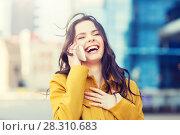 Купить «smiling young woman or girl calling on smartphone», фото № 28310683, снято 12 мая 2016 г. (c) Syda Productions / Фотобанк Лори