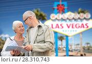 Купить «senior couple with map travelling to las vegas», фото № 28310743, снято 4 сентября 2014 г. (c) Syda Productions / Фотобанк Лори