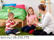Купить «kids and mother with modelling clay or slimes», фото № 28310775, снято 15 октября 2017 г. (c) Syda Productions / Фотобанк Лори