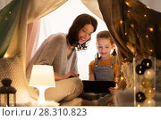 Купить «family with tablet pc in kids tent at home», фото № 28310823, снято 27 января 2018 г. (c) Syda Productions / Фотобанк Лори