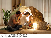 Купить «father telling scary stories to his daughter», фото № 28310827, снято 27 января 2018 г. (c) Syda Productions / Фотобанк Лори