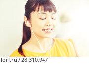 Купить «happy asian woman with earphones listening music», фото № 28310947, снято 9 марта 2016 г. (c) Syda Productions / Фотобанк Лори
