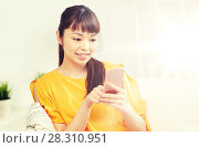Купить «happy asian woman with smartphone at home», фото № 28310951, снято 9 марта 2016 г. (c) Syda Productions / Фотобанк Лори