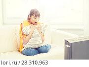 Купить «asian young woman watching tv at home», фото № 28310963, снято 9 марта 2016 г. (c) Syda Productions / Фотобанк Лори