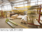 Купить «boards storing at woodworking factory warehouse», фото № 28311043, снято 10 ноября 2017 г. (c) Syda Productions / Фотобанк Лори