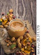 Купить «Natural peanut butter», фото № 28311179, снято 11 апреля 2018 г. (c) Jan Jack Russo Media / Фотобанк Лори