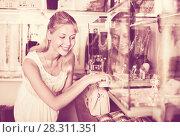 Купить «Portrait of young woman standing next to glass showcases», фото № 28311351, снято 19 августа 2018 г. (c) Яков Филимонов / Фотобанк Лори