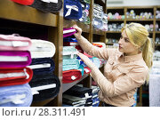 Купить «woman choosing textiles for dressmaking», фото № 28311491, снято 2 марта 2018 г. (c) Яков Филимонов / Фотобанк Лори