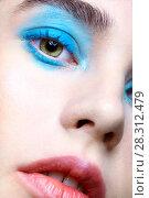 Купить «Closeup macro portrait of female face. Human woman half-face with unusual beauty makeup. Girl with perfect skin, green pistachio colour eyes and blue shadows make-up», фото № 28312479, снято 22 марта 2018 г. (c) Serg Zastavkin / Фотобанк Лори