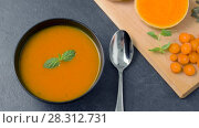 Купить «close up of vegetable pumpkin cream soup in bowl», видеоролик № 28312731, снято 8 апреля 2018 г. (c) Syda Productions / Фотобанк Лори