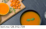 Купить «close up of vegetable pumpkin cream soup in bowl», видеоролик № 28312739, снято 8 апреля 2018 г. (c) Syda Productions / Фотобанк Лори