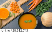 Купить «close up of vegetable pumpkin cream soup in bowl», видеоролик № 28312743, снято 8 апреля 2018 г. (c) Syda Productions / Фотобанк Лори