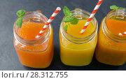 Купить «close up of fresh juices in mason jar glasses», видеоролик № 28312755, снято 8 апреля 2018 г. (c) Syda Productions / Фотобанк Лори