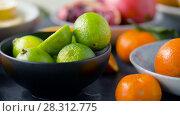Купить «close up of limes, oranges, mandarins and lemons», видеоролик № 28312775, снято 8 апреля 2018 г. (c) Syda Productions / Фотобанк Лори