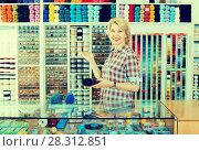 Купить «mature woman at counter in sewing store», фото № 28312851, снято 12 декабря 2018 г. (c) Яков Филимонов / Фотобанк Лори