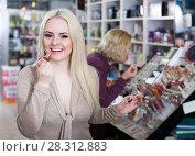 Купить «mother and daughter choosing lipstick on display and smiling», фото № 28312883, снято 23 октября 2018 г. (c) Яков Филимонов / Фотобанк Лори