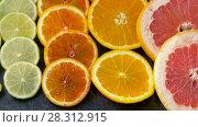 Купить «close up of grapefruit, orange, lemon and lime», видеоролик № 28312915, снято 8 апреля 2018 г. (c) Syda Productions / Фотобанк Лори
