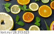 Купить «close up of grapefruit, orange, pomelo and lime», видеоролик № 28313023, снято 8 апреля 2018 г. (c) Syda Productions / Фотобанк Лори